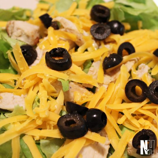 chicken, cheese, olives, & greens salad